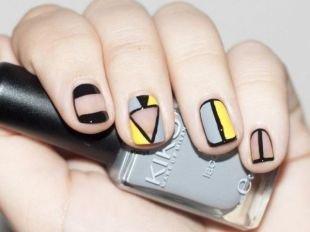 Египетские рисунки на ногтях, стильный геометрический маникюр